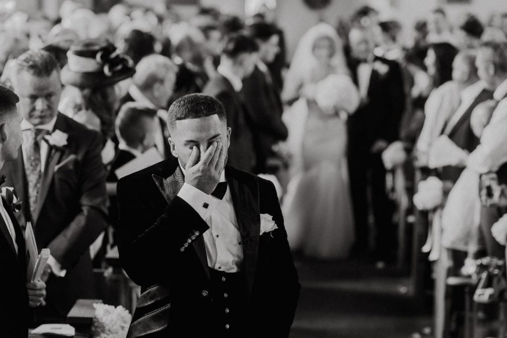 Yorkshire wedding photographer, groom cries as bride walks down the aisle at church wedding