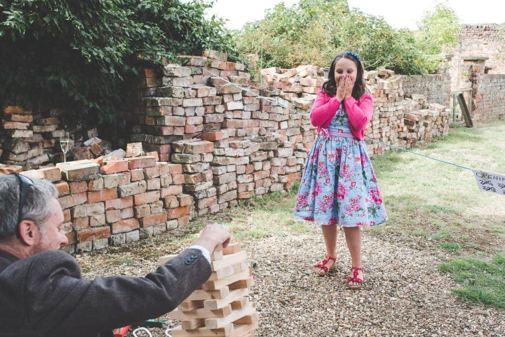 Barff House Wedding, child wedding guest shocked as jenga tower falls
