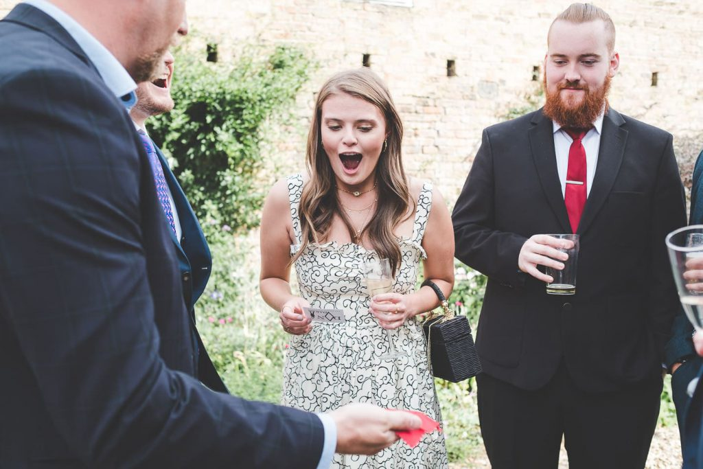 Barff House Wedding, guests amazed as magician does a trick for them